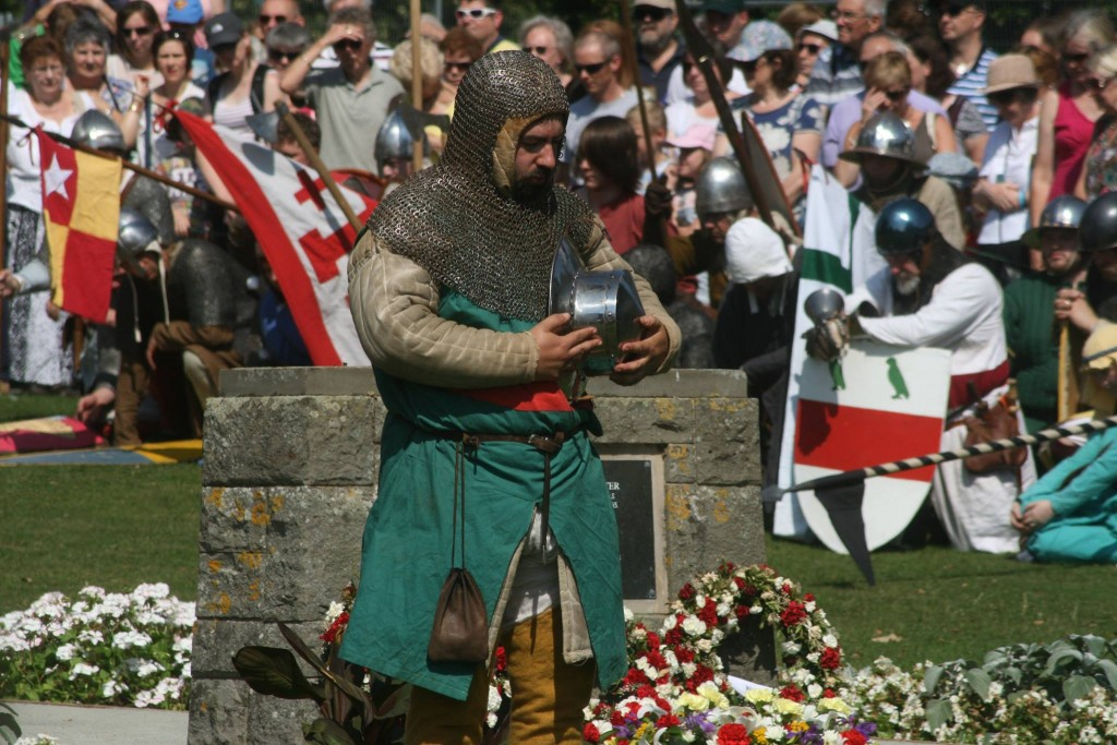 Re-enactors places wreaths at the Simon de Montfort memorial in Abbey Park, Evesham